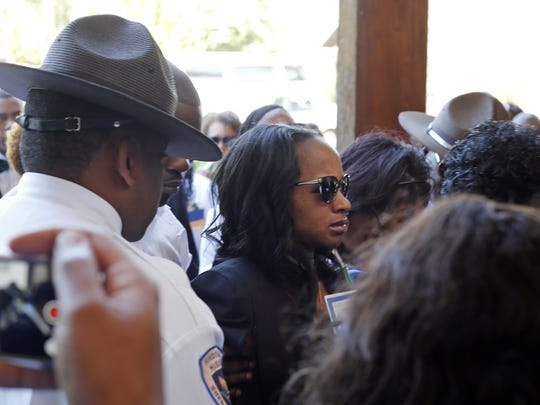 Ebony Archie, mother of  Kingston Frazier, arrives for her son's funeral at Morning Star Baptist Church in Jackson Friday.