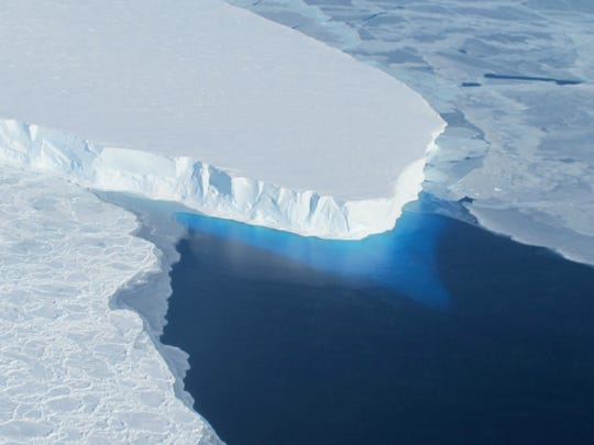 A major ice sheet in western Antarctica is melting, and its collapse could raise the global sea level nearly 2 feet, though that could take centuries.