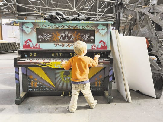 Asher Palmer, age 3 here, grandson of Reno Councilman Dave Aiazzi, plays on a 2011 Artown piano in the Salvagery building.