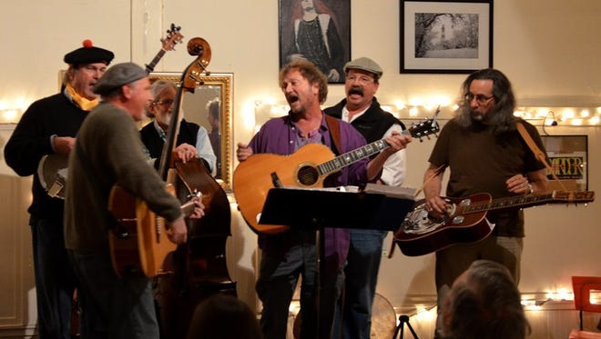 A group performs during Chincoteague Cultural Alliance's monthly coffeehouse event. The alliance, formed in 2004, works to enhance the Chincoteague community by providing arts and culture to the island.