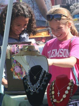 These youngsters enjoy the jewelry they are checking out in a vendor booth Sunday at the Smith Valley Fun Day.