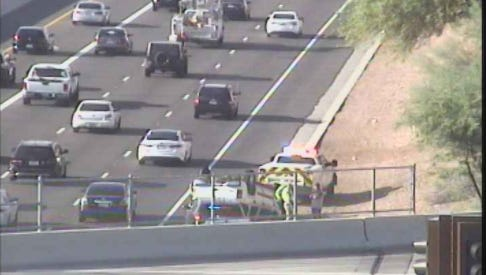 A rollover on Loop 101 near Guadalupe Road, near the Mesa-Tempe border, was causing morning-commute traffic delays on Aug. 14, 2017.