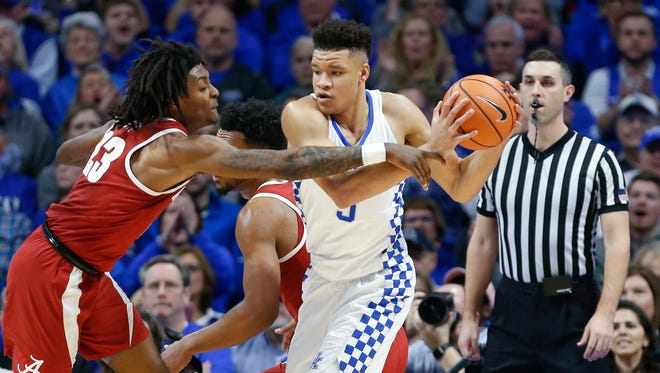 Kevin Knox #5 of the Kentucky Wildcats grabs a rebound from John Petty #23 of the Alabama Crimson Tide during the second half at Rupp Arena in Lexington, KY., on February 17, 2018. Kentucky Wildcats defeated Alabama Crimson Tide 81-71.