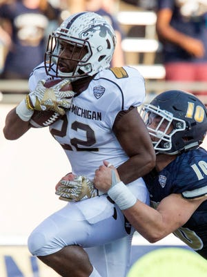 Western Michigan running back Davon Tucker (22) scores a touchdown in the Broncos' 41-0 win at Akron on Saturday.
