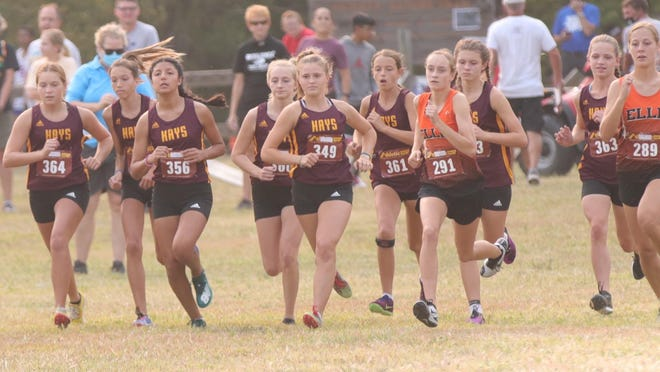 The Hays High girls cross country team begins Thursday's race in the Hays High Invitational at Sand Plum Nature Trail in Victoria.