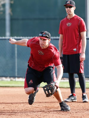 Arizona Diamondbacks first baseman Paul Goldschmidt charges a ground ball on Thursday, Feb.19, 2015, in Scottsdale. Pitchers and catchers officially reported to spring training camp.