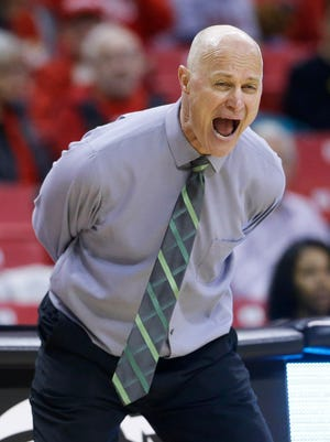 Green Bay head coach Kevin Borseth directs his players in the second half of an NCAA college basketball game against Princeton in the first round of the NCAA tournament, March 21, in College Park, Md. Princeton won 80-70.