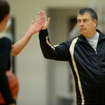 Lebanon boys basketball coach Albert Hendrix, who is trying to return as coach after open-heart surgery, works with his players during a recent practice., Nov. 18, 2014.