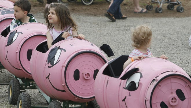 French Prairie Gardens hosts a harvest festival that features a pig train.