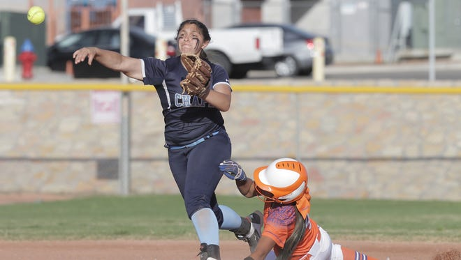 Chapin short stop Ariana Valles throws to first to complete the double play after outting Canutillo's Kayla Ferniza at second.