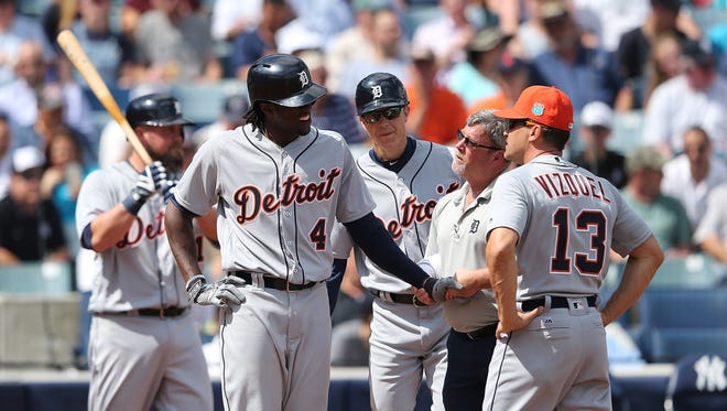 Cameron Maybin is checked by trainer Kevin Rand after getting hit in the first inning against the Yankees.