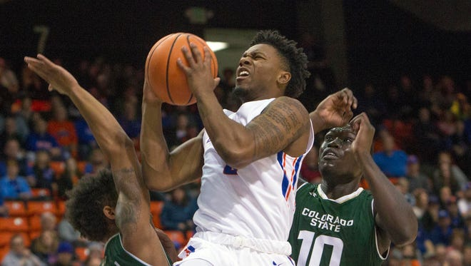 Boise State guard Marcus Dickinson drives to the basket while defended by Colorado State's Che Bob (10) and Prentiss Nixon during their game last week.