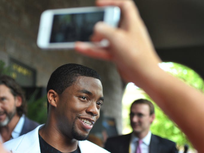 """Chad Boseman, star of the James Brown biopic 'Get On Up,"""" makes his way along the red carpet during Sunday's screening at the Malco Grandview Cinema in Madison."""