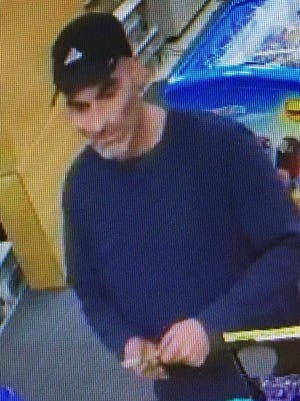 Authorities say this surveillance image shows Joseph Bush of Gloucester City at Somerdale News and Tobacco Outlet, which he is accused of robbing Thursday night.