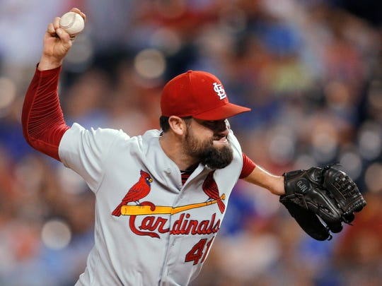 St. Louis Cardinals relief pitcher Pat Neshek delivers to a Kansas City Royals batter during the 11th inning of a baseball game at Kauffman Stadium in Kansas City, Mo., Wednesday, June 4, 2014. The Cardinals defeated the Royals 5-2 in 11 innings. Neshek earned the save.