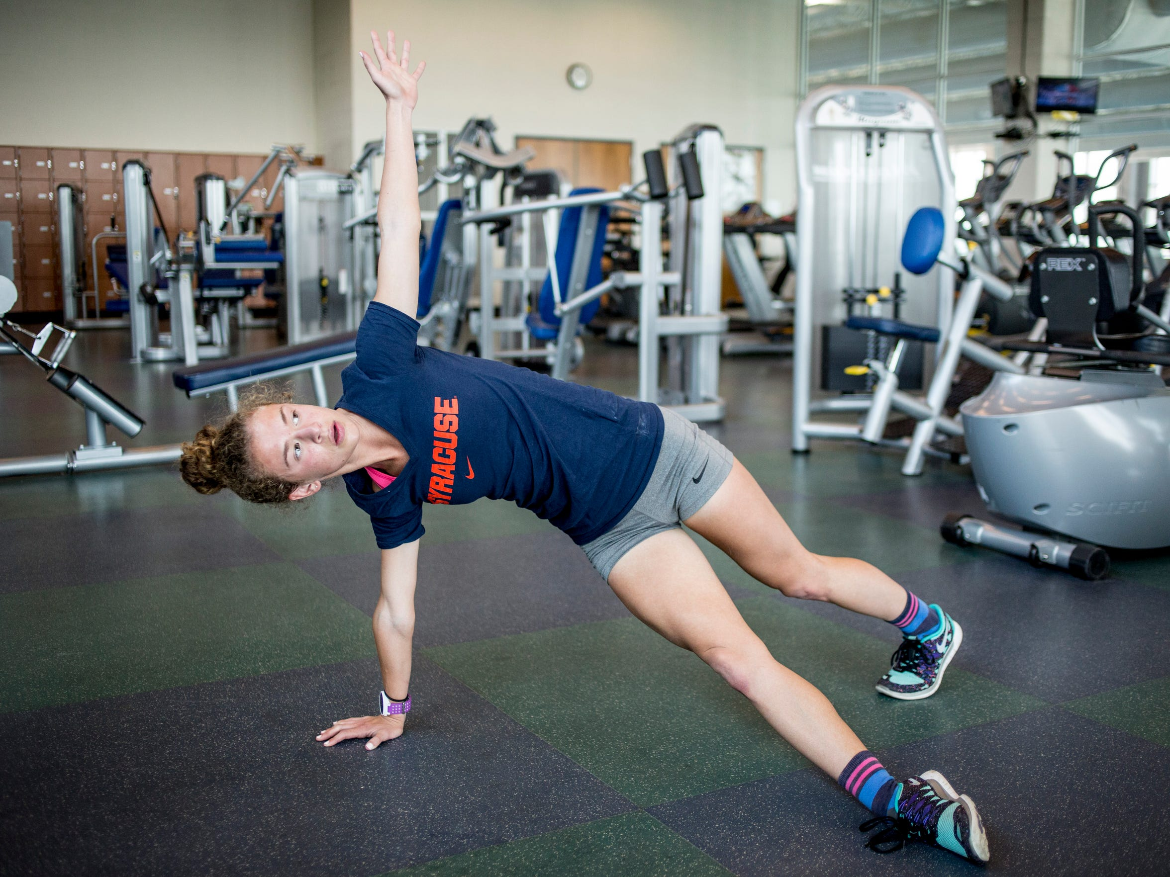 Rachel Bonner does a rotational plank Wednesday, May