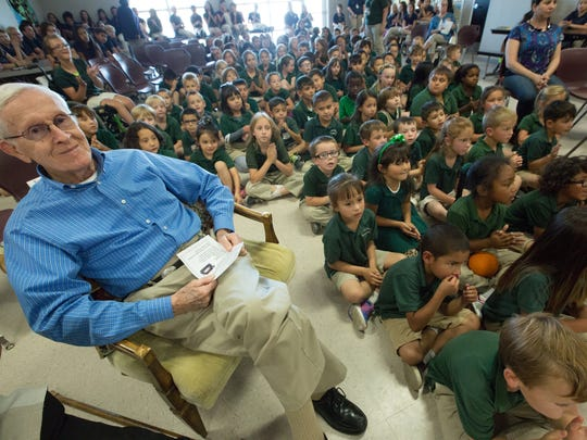 John Paul Taylor sits among students from the J. Paul Taylor Academy as a 15-year time capsule is filled on Tuesday, May 24, 2016.