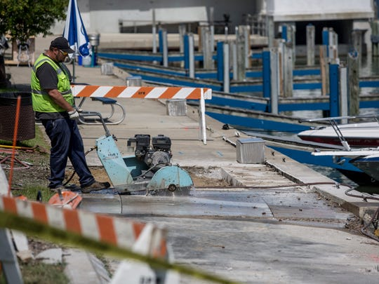 City workers cut sections of concrete where the seawall is failing Thursday, June 2, 2016 on the Black River near Seventh Street in Port Huron.