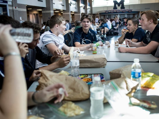 Students eat at tables during the lunch hour Friday, September 9, 2016 at Marysville High School. Marysville High School has adopted a nut-free policy for the school.