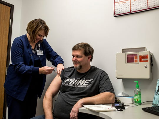 Registered Nurse and Immunization Coordinator Barb Todaro gives a flu shot to Tim VanBuskirk, of Avoca, Friday, Jan. 13, 2017 at the St. Clair County Health Department.