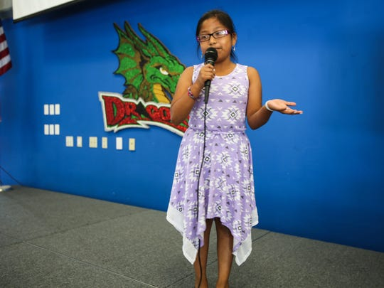 "Angelica Garcia, 9, recites her poem, titled ""The Sun,"" at Immokalee Community School on Friday, May 26, 2017. Angelica and 14 other ICS students will be published in the fall issue of ""A Celebration of Poets."""