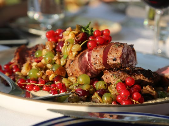 Chef Sarah Welch's Sweet Grass Farms lamb loin with chutney and red currants from the Outstanding in the Field dinner at Detroit's Food Field farm on August 15, 2017.