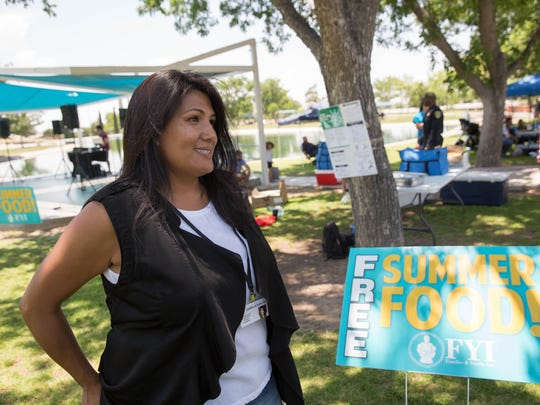 Lorena Lozoya, the summer food program coordinator for Families and Youth Inc., talks about the free summer food program Wednesday June 6, 2018, at Young Park.