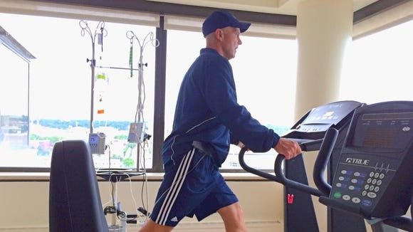 Photo courtesy of Todd Stroud  Todd Stroud gets in a daily walk on a treadmill at the Cleveland Clinic, where he?s being treated for a rare blood disorder.