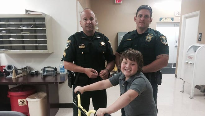 Sgt. Bogliole, Deputy Hardin & Philip after he got his bike back.
