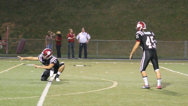 Asheville High senior James Ramming (45) was the kicker for the 2014 Mountain Athletic Conference 3-A champions.