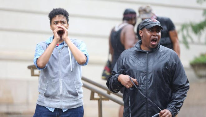 """Black Lives Matter Cincinnati members chant """"Sam's life matters"""" during a protest Wednesday."""