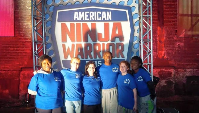 """Miles Avery (center right) took poses with family and friends during filming for """"American Ninja Warrior."""""""