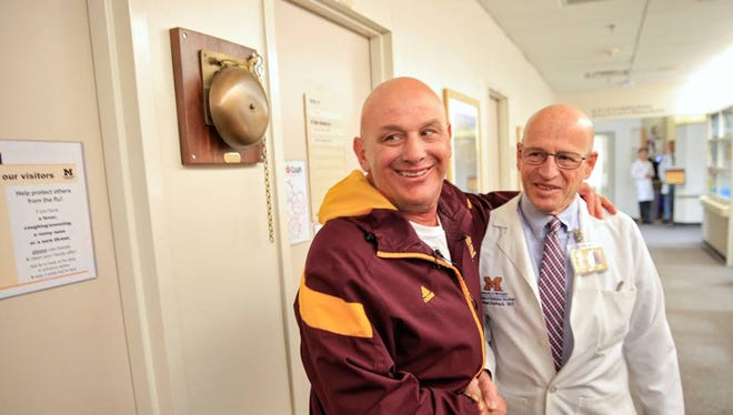 CMU football coach John Bonamego after he completed radiation treatment at University of Michigan's Cancer Center in Ann Arbor.