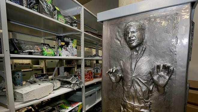 "A 7-foot fiberglass replica of ""Han Solo in Carbonite"" dominates an aisle of the subterranean archives at the Children's Museum of Indianapolis. Inspired by a famous scene in 1980 ""Star Wars"" film ""The Empire Strikes Back,"" the sculpture was made by now-defunct company Illusive Concepts in 1997. The museum's piece is No. 850 in a limited-edition series of 2,500. Today, online sellers seek $3,500 for ""Han Solo in Carbonite."""