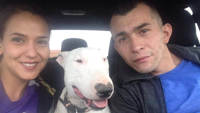 Martin Serna and Sonia Gonzalez pose with their dog Mac, who was later shot by a Las Cruces Police officer responding to a report of a vicious dog.