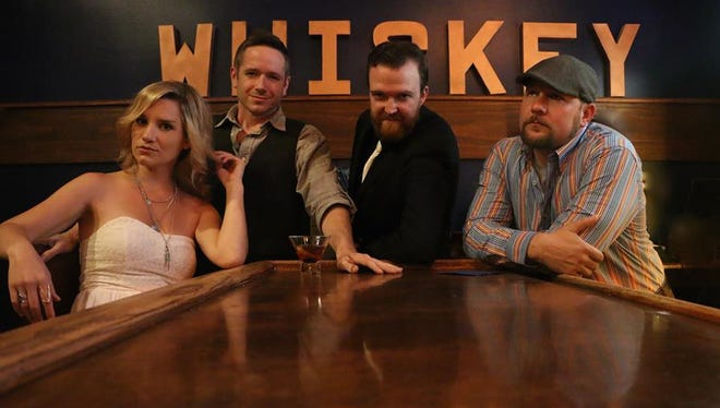 Whiskey & Water's recent Vinyl Music Hall show became even more memorable when T.J. Wood proposed to bandmate Christel Voila on stage.