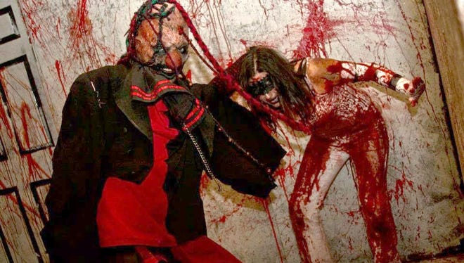 Timothy and Gina Yarbough in action inside The Realm of Darkness haunted house.