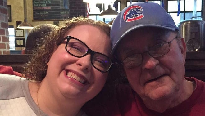 Sarah Zmina and her dad, Larry Holtsclaw, are lifelong Chicago Cubs fans.
