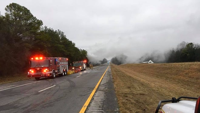 Emergency crews on scene of a semi fire involving hazardous materials that has shut down I-24 in Rutherford County Wednesday, Dec. 14, 2016
