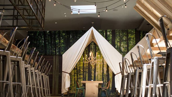 The nature and safari-themed restaurant nods to glamping with this tent.