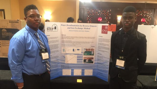 Amir Gidden, left, and Jhavere Erskine, right, presented their findings from testing water filtration methods at a Science and Technology Entry Program, STEP, conference in Albany. They earned second place at the conference.