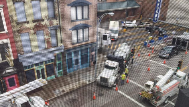 Duke Energy crews work at the Kroger in Over-the-Rhine on Sunday after an overnight storm knocked out the transformer.
