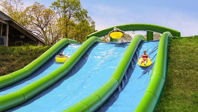 A 600-foot inflatable water slide opens at Roundtop Mountain Resort in Warrington Township for Memorial Day weekend.