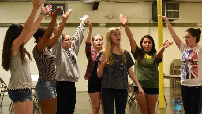 """Kristy Jackson (Elle Woods) and the cast of SPARE Production's """"Legally Blonde"""" rehearse a dance number."""