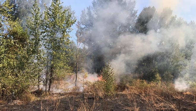 Keizer Fire investigating the cause of a five-acre fire that occurred at the Keizer Rapids Park on Thursday, August 17, 2017.
