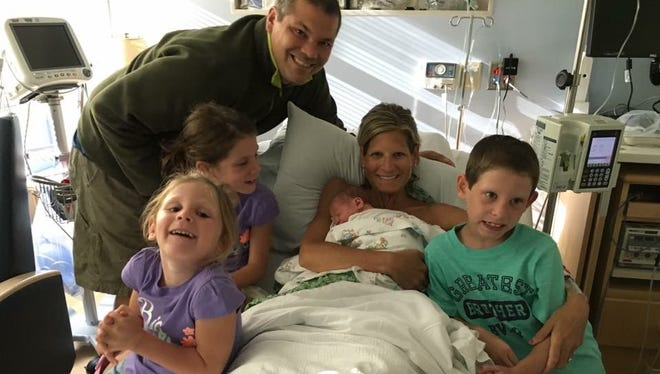 The Braatz family meets baby Caleb for the first time.