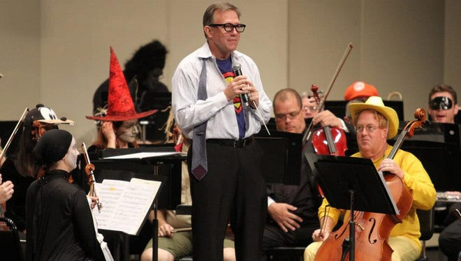 Christopher Confesore, conductor of the Brevard Symphony Orchestra, dons a Superman costume for a Halloween-themed free family concert at a previous Cultural Arts Showcase.