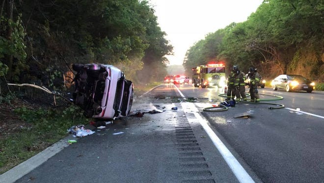 A car caught fire and flipped on its side, but there were only minor injuries.