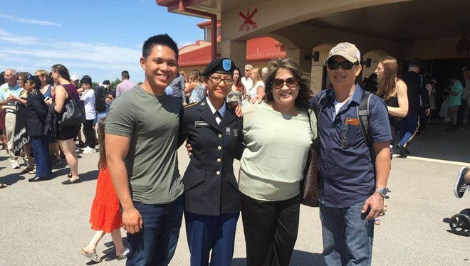 "Private first class Chyryll Crisologo Floranda graduated from Basic Training with honors on June 22, 2018 at Fort Sill Oklahoma. She was assigned to A Battery I-79 FA BN 1st Platoon ""Reapers"" during her time at Fort Sill. We are very proud of her achievements. She is proud to be the only person in her platoon to be from Guam. Pictured from left: Jerico Floranda (Husband of Chyryll, Pfc. Chyryll Crisologo Floranda, Jesselyn A. Crisologo (mother), and Rodolfo S. Crisologo Jr. (father)."