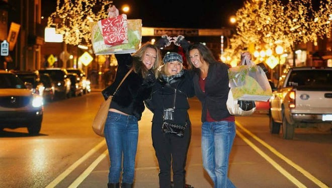 Among the activities offered during Ladies Night Out in Brighton is the opportunity to pose for photos with friends on a Main Street crosswalk.